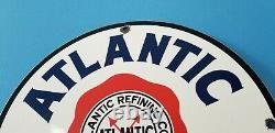 Panneau Publicitaire De La Vieille Station De Service De L'essence De Porcelaine De L'atlantique